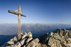 summit cross on ifinger mountain above merano with a view into the passaierta - stock photo