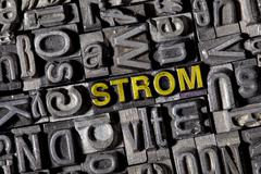 "Old lead letters spelling the word ""strom"", german for power Stock Photos"
