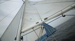 Sailboat with main sail up Stock Footage