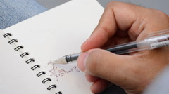 Pencil of sketcher painting in a book Stock Footage