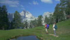 AERIAL: Hikers in the most beautiful part of European Alps Stock Footage