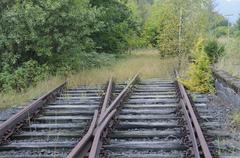 Tracks running into the countryside at a disused railway station on a regiona Stock Photos