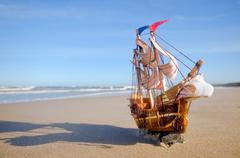 ship model on summer sunny beach. travel, voyage, vacation concepts - stock photo