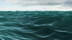 Stock Video Footage of Choppy blue ocean under cloudy sky