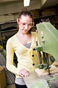 Teenage schoolgirl in the handwork classroom Stock Photos