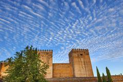 alhambra castle walls morning sky granada cityscape andalusia spain - stock photo