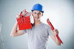 young craftsman holding a tool box - stock photo