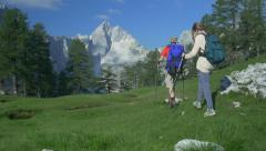 AERIAL: Couple of young hikers in the mountains Stock Footage