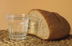 Bread and water, symbolic image for hunger, dieting Stock Photos