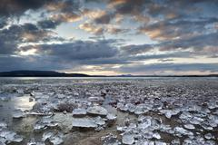 Chunks of ice lying on icy surface on the shore of reichenau island, baden-wu Stock Photos