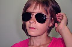 child wearing sunglasses - stock photo