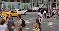 Crowd of people walking crossing street intersection time-lapse 4k - stock footage