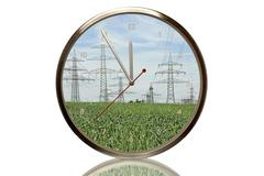 Clock with power poles, 5 minutes to twelve, eleventh hour, symbolic image fo Stock Photos