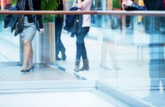 people in rush in a modern shopping mall. - stock photo