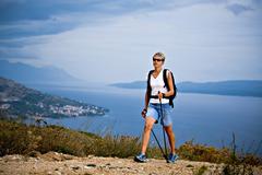Woman hiking at the seaside, omis, adriatic coast, croatia, europe Stock Photos