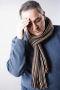 Elderly man with a headache Stock Photos