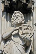 figure of a saint on the west facade of the koelner dom, cologne cathedral, n - stock photo