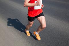 marathon runner on the way. running, a healthy exercise - stock photo