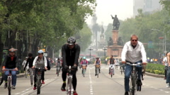 FULL SHOT. Cyclists and runners enjoying a Sunday trip. Stock Footage