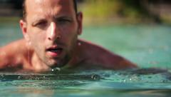 Man in the swimming pool with breast stroke HD Stock Footage