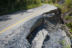 destroyed tarmac road, northern thailand, thailand, asia - stock photo