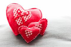 handmade plush red hearts on the soft pillow. romantic love, valentine's day  - stock photo