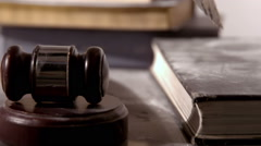 Dollars falling beside hammer and gavel - stock footage