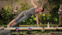 Woman doing exercises in the exotic garden HD Stock Footage