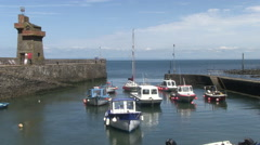 Boats in lynmouth harb our by the rhenish tower in north devon Stock Footage