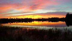 Beautiful sunset park lake, tri color sky. Stock Footage