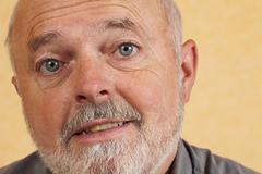 Elderly man, 59, looking sceptical Stock Photos