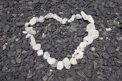 a heart shape made with some of the few white pebbles available on ko hin nga - stock photo