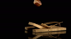 Mousetrap snapping on piece of bread Stock Footage