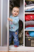Baby in wardrobe, 1 year Stock Photos