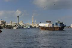 dhow in front of the backdrop of bur dubai, united arab emirates, arabia, ara - stock photo