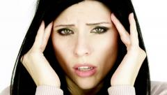 Woman shouting for pain of headache tight closeup Stock Footage