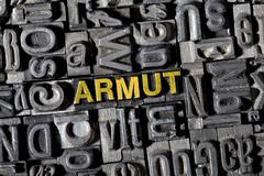 """Stock Photo of old lead letters forming the word """"armut"""", german for """"poverty"""""""