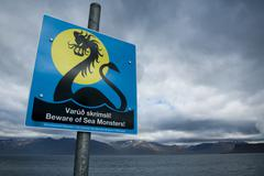 street sign, beware of sea monsters, near the town of þingeyri, thingeyri, d - stock photo