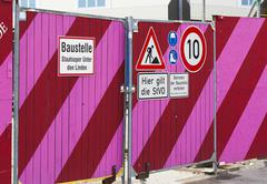 Colourful hoarding with road signs at the staatsoper unter den linden, berlin Stock Photos