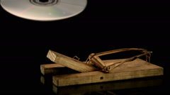 Mousetrap snapping on cd rom breaking it Stock Footage