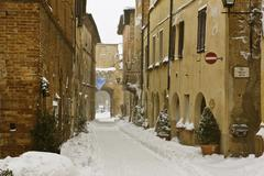 snow-covered road in pienza, tuscany, italy, europe - stock photo