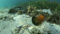 Underwater trash lying in ocean tidal mark - stock footage