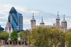 The tower of london and the 30 st mary axe skyscraper aka the gherkin, englan Stock Photos