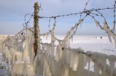 Icy barbed wire, frozen black sea, a rare phenomenon, odessa, ukraine, easter Stock Photos