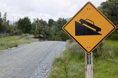 Chilean street sign, caution slope, carretera austral, ruta ch7 road, panamer Stock Photos