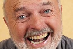 Elderly man, 59, laughing Stock Photos