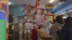 Customers inside steamed bun (baozi shop) Stock Footage