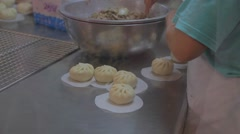 Woman shapes the steamed bun Stock Footage