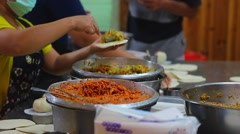Woman making curry vegetable filling for steamed bun Stock Footage