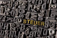"the word ""steuer"", german for ""tax"", made of old lead type - stock photo"